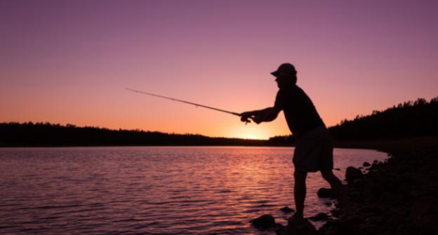 man fishing sunrise